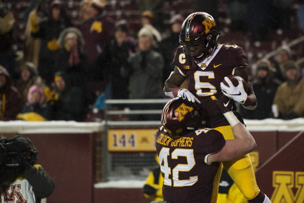 In a game full of mistakes, star wide receiver Johnson shines in Gophers victory