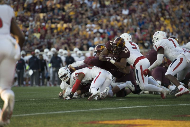Redshirt Sophomore Seth Green attempts to avoid a tackle during the Gopher game against Fresno State on Saturday, Sept. 8 at TCF Bank Stadium.