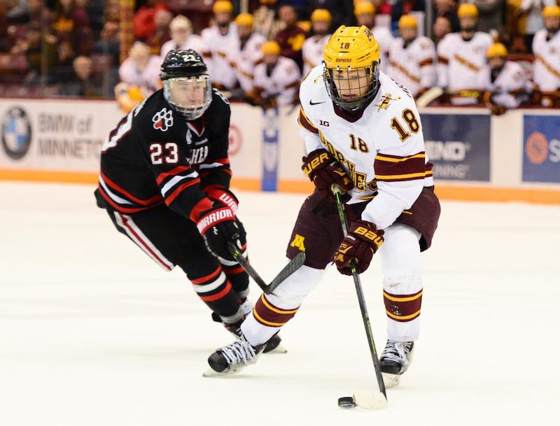 Forward Leon Bristedt handles the puck while playing against Northeastern in Mariucci Arena on Saturday, Oct. 24, 2015.