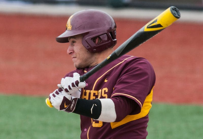 Michael Handel hits the ball during the baseball game against Nebraska on Sunday afternoon at Siebert Field.