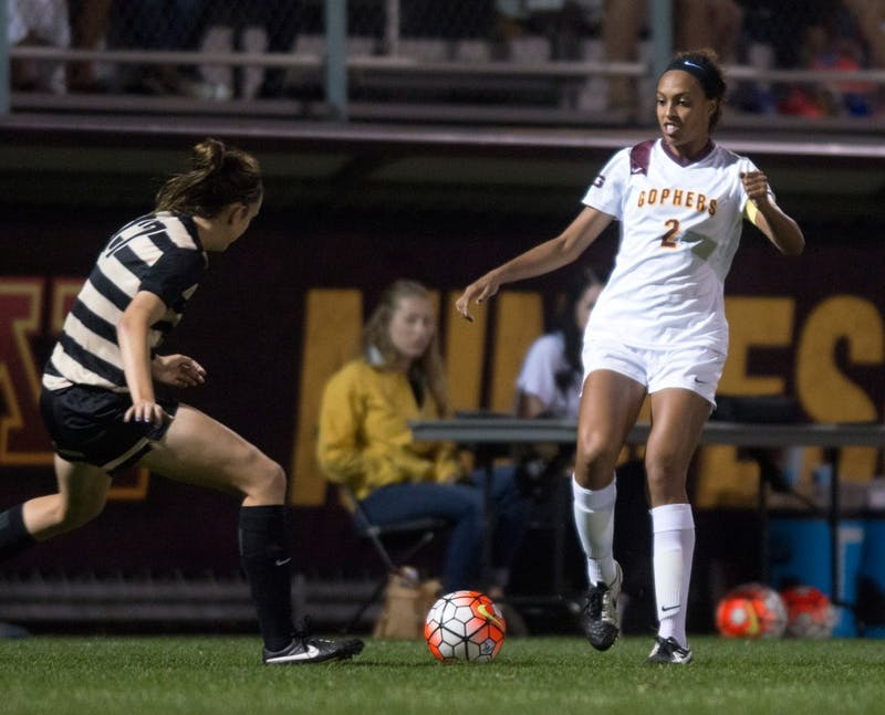 Gophers forward Simone Kolander fights for the ball at Elizabeth Lyle Robbie Stadium on Friday, Sept. 25.