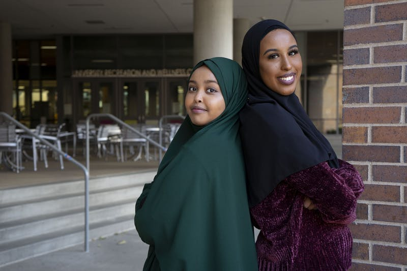 Sumaya Noor, left, and Fahima Osman, right, pose for a portrait outside of the University Recreation and Wellness Center on Saturday, Nov. 16. Noor and Osman initiated a women's only fitness project after their project discovered many Somali women do not exercise due to a lack of available spaces.