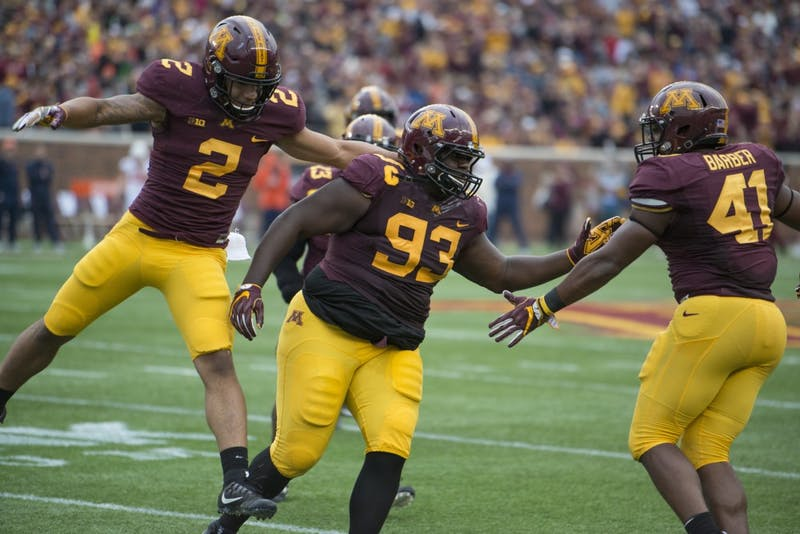 Merrick Jackson celebrates his forced fumble with Thomas Barber at the homecoming game against Illinois at TCF Bank Stadium on Saturday, Oct. 21.