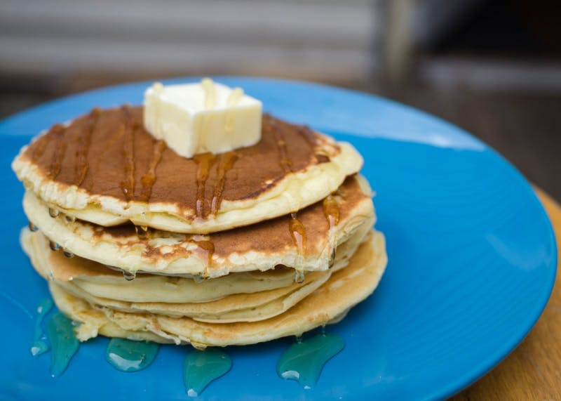 Greek yogurt pancakes, topped with honey and butter.