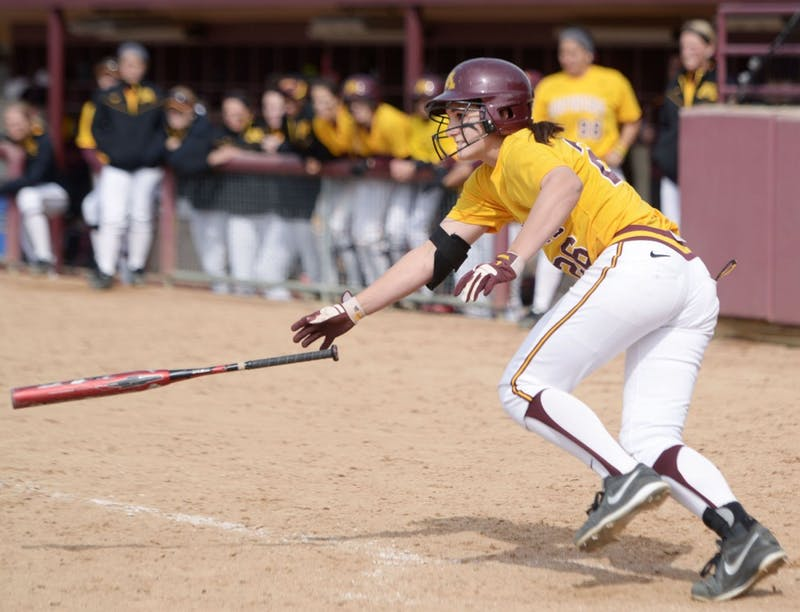 Minnesota infielder Kaitlyn Richardson throws her bat after a base hit against Wisconsin on April 7, 2013, at Jane Sage Cowles Stadium.