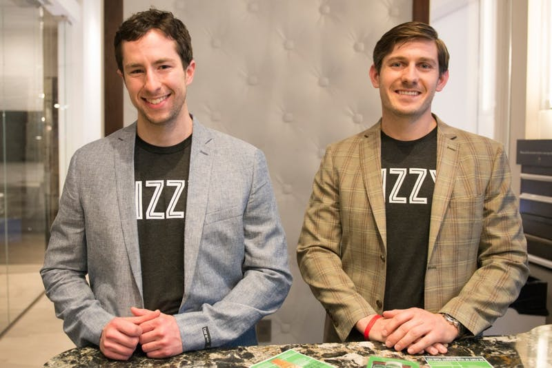 Co-founders of Bizzy Coffee Alex French, left, and Andrew Healy stand for a portrait at the official Bizzy Grand Launch Party at the Cambria Gallery on Saturday.