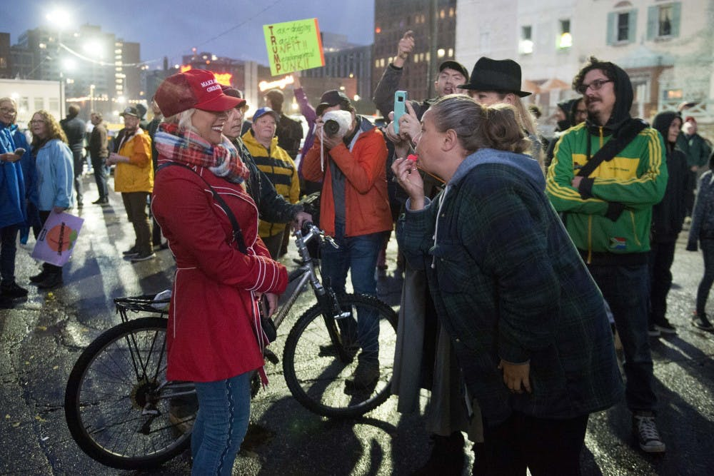 Supporters, protesters flock to Minneapolis for Trump rally