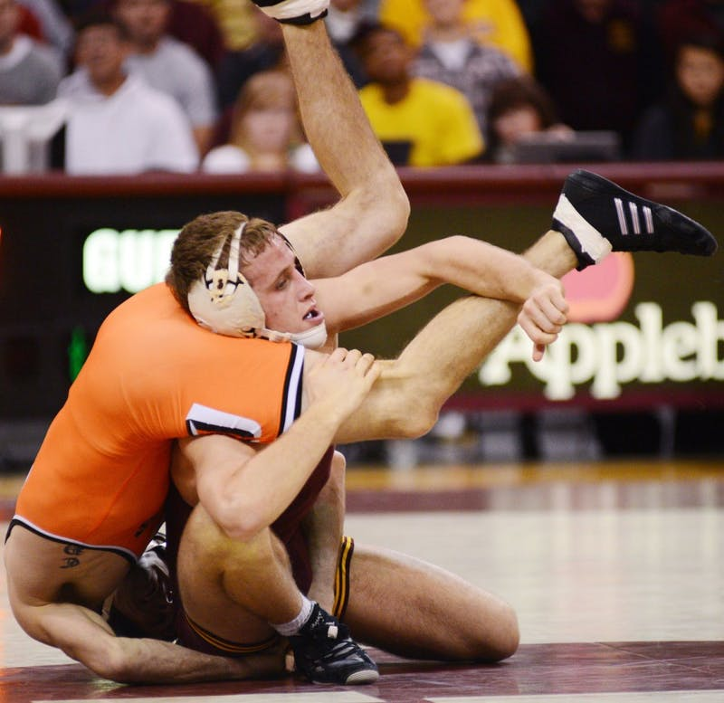 Minnesota's David Thorn wrestles against Oklahoma's Tyler Dorrell on Sunday, Dec. 2, 2012, at the Sports Pavilion.