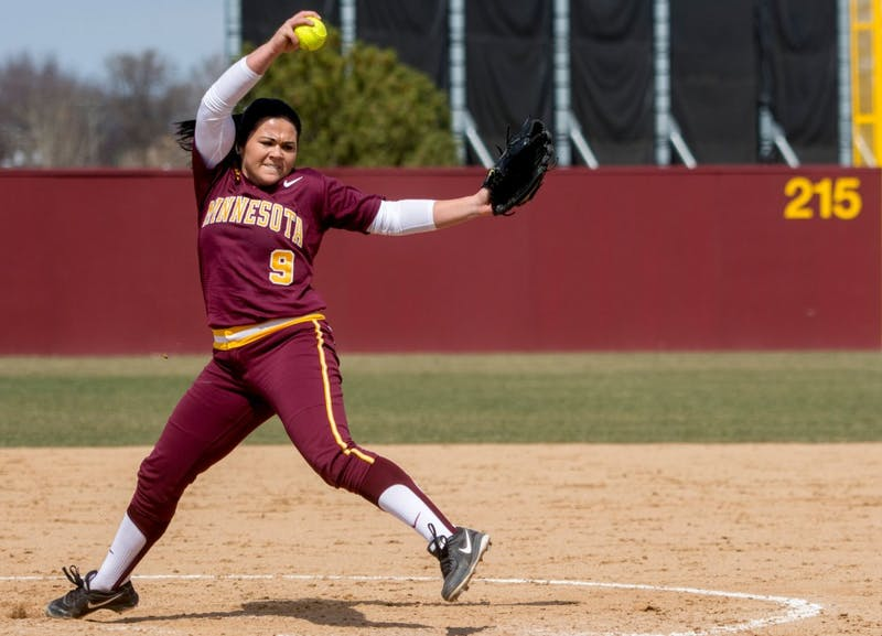 Freshman Kylie Stober delivers a pitch at Jane Sage Cowles Stadium on April 4.