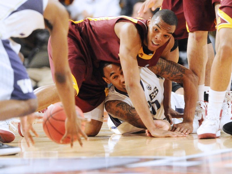A late turnover almost sunk the Gophers when Joe Coleman andAndre Hollins couldn't handle the ball Tuesday at Madison SquareGarden. The Huskies converted a basket following the turnover to trimthe Gophers' lead.