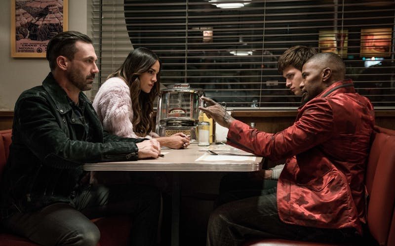 Left to right: Buddy (Jon Hamm), Darling (Eiza Gonzalez), Baby (Ansel Elgort) and Bats (Jamie Foxx) discuss the next heist in TriStar Pictures' Baby Driver.