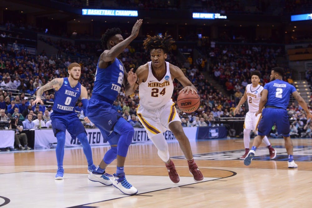 Gophers forward Eric Curry out for season with ACL, MCL and meniscus tear