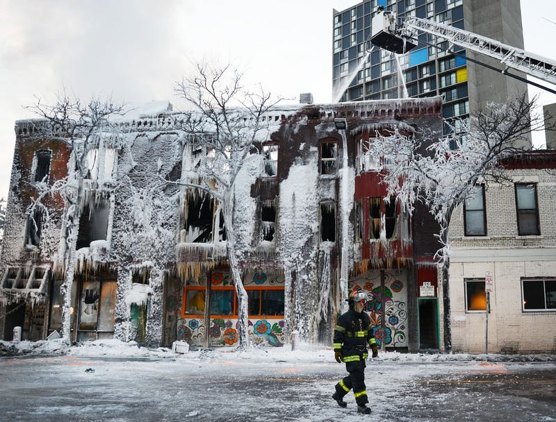 Firefighters continue to hose down Minneapolis apartments and a grocery store that exploded and caught fire Wednesday morning near Cedar Riverside. A total of 14 people were taken to hospitals, 6 in critical condition. The cause of the fire is still being investigated.