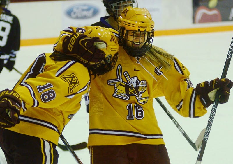 Minnesota forwards Brook Garzone and Bethany Brausen celebrate a goal at Ridder Arena on Nov. 22, 2013.