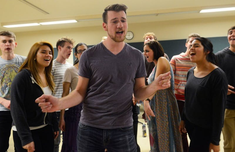 Urban Sound, a co-ed a cappella ensemble, rehearses in Ferguson Hall on April 13, 2015. The group is one of five a cappella groups that will be performing at Coffman Union on April 18, 2015.