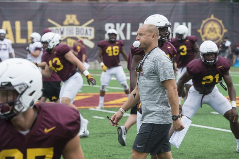 Head Football Coach P.J. Fleck blows a bubble at the Athletes Village practice field on Monday, Aug. 20.