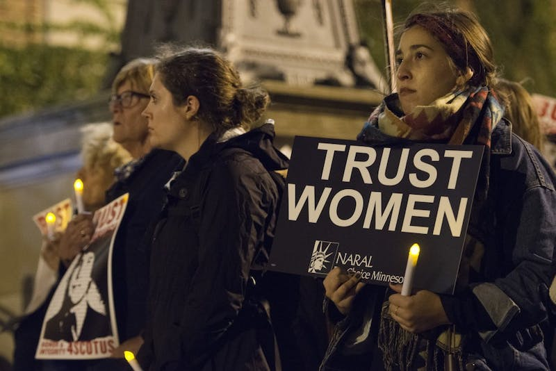 Supporters of Dr. Christine Blasey Ford gathered at Northrop Plaza for a vigil on Wednesday, Oct. 3.