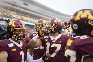 Wide receiver Seth Green hypes the team up before the start of the game at TCF Bank Stadium on Saturday, Nov. 30.