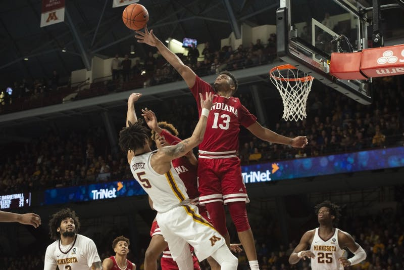 Forward Juwan Morgan swats Amir Coffey's shot from the basket during the game against Minnesota on Saturday, Feb. 16. The Gophers won 84-63.