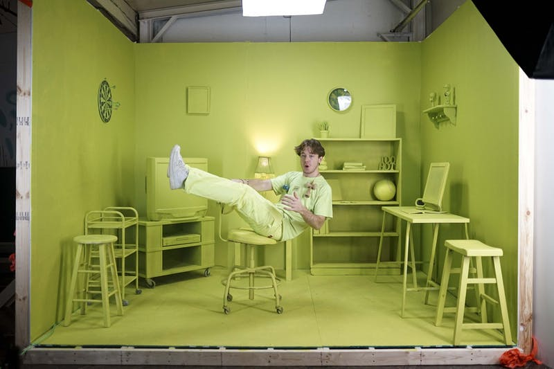 "Eddy poses for a portrait in a custom built studio he designed to promote a new pro model Kendama on Monday, Nov. 18. A video he produced, ""Coop's room,"" found inspiration from how common it is for many kids to play Kendama in their own room and the vibrant, green color of his new model."
