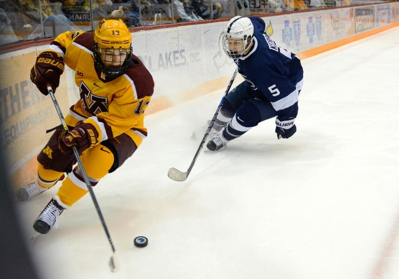 Gophers forward Taylor Cammarata handles the puck while playing against Penn State at Mariucci Arena on Saturday night. Minnesota fell to Penn State with a final score of 3-5.