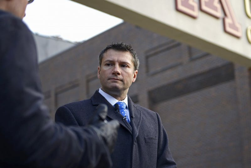 """Ryan Pacyga, attorney for University of Minnesota football player Antoine Winfield Jr., addresses the press in front of the Gibson-Nagurski Football Practice Facility on Saturday. """"Their names are attached to these [acquisitions] for the rest of their life,"""" Pacyga said."""