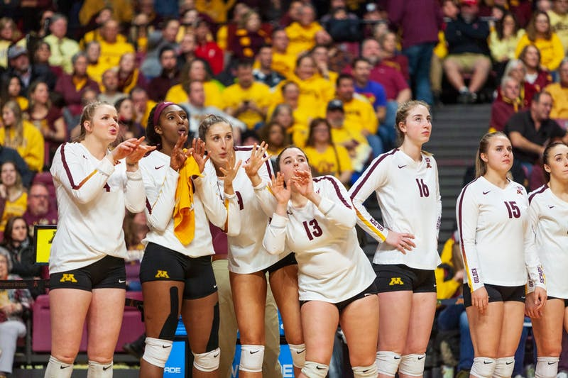 The Gophers watch from the sidelines at the Maturi Pavilion on Thursday, Nov. 14. They ended the night with a 3-1 loss against the Badgers.
