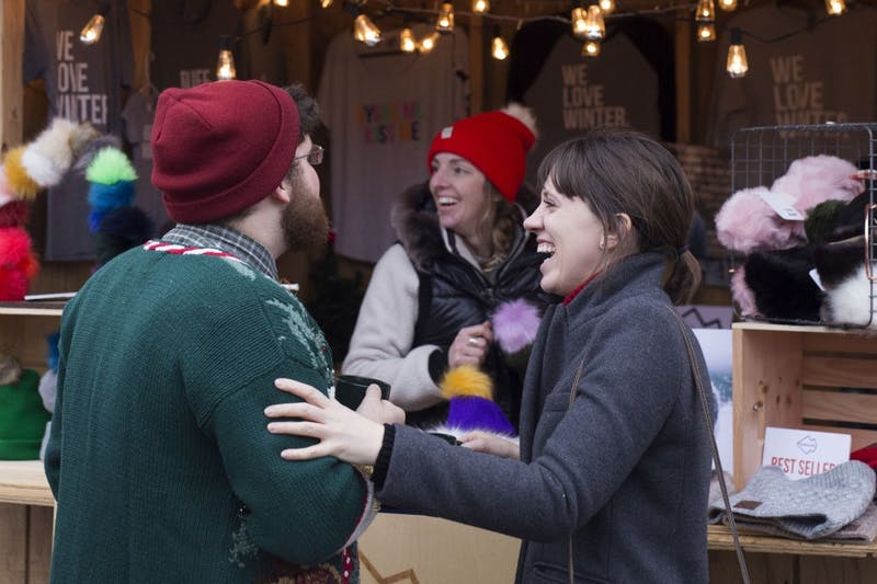 Jeremy and Celeste enjoy the The European Christmas Market on Dec. 2 in Saint Paul. The open-air market features vendors selling European holiday items.