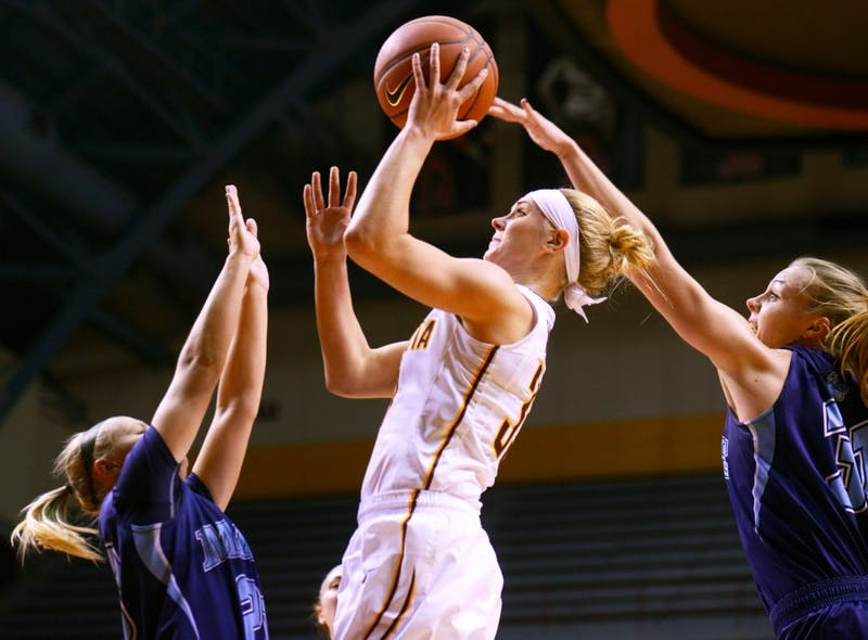 Carlie Wagner manages to shoot in-between two Maine defenders on Friday night at Williams Arena where Gophers defeated Maine 91-64.
