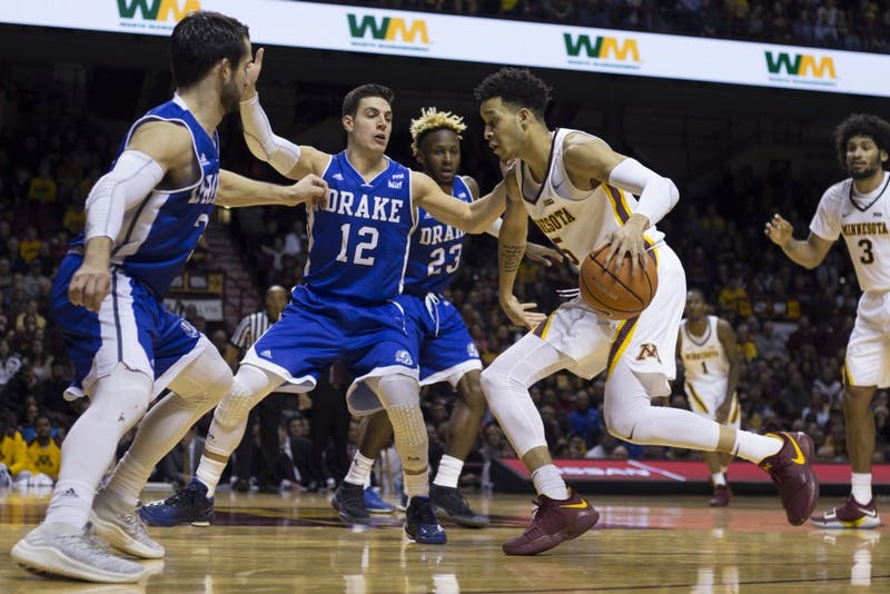 Sophomore guard Amir Coffey dribbles toward the hoop during the game against Drake on Monday, Dec. 11 at Williams Arena. The Gophers won 68-67.