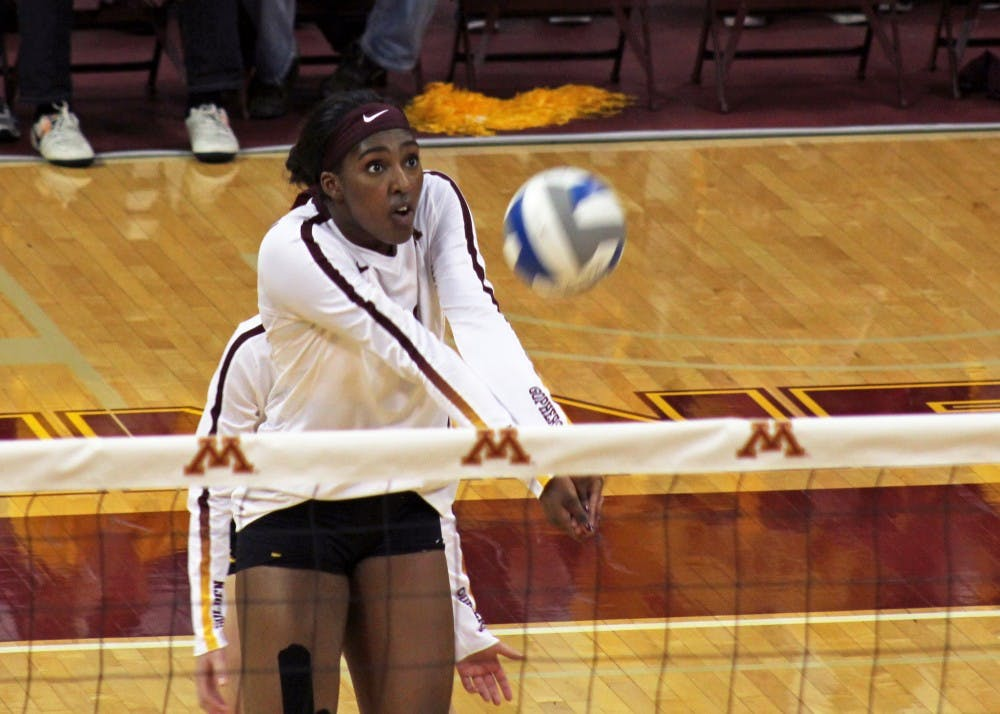 Gophers finish road matches with three-set win, upset loss