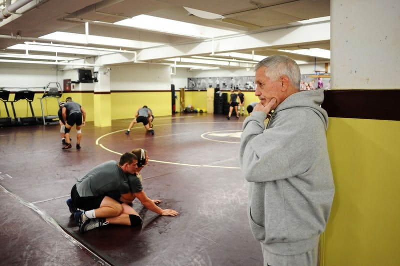 Former wrestling head coach J Robinson oversees a practice on September 18, 2012.