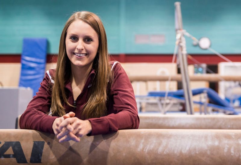 Team manager for the women's gymnastics team Megan Alvarez, Friday at the Piek Gymnasium, where the team practices.