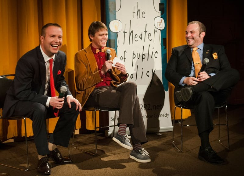 Rep. Nick Zerwas, R-Elk River, University public affairs student Tane Danger and Rep. Dan Schoen, DFL-St. Paul Park, talk Minnesota politics in the Cowles Auditoriom and Atrium on Wednesday night. Danger is the co-founder of the Theater of Public Policy.
