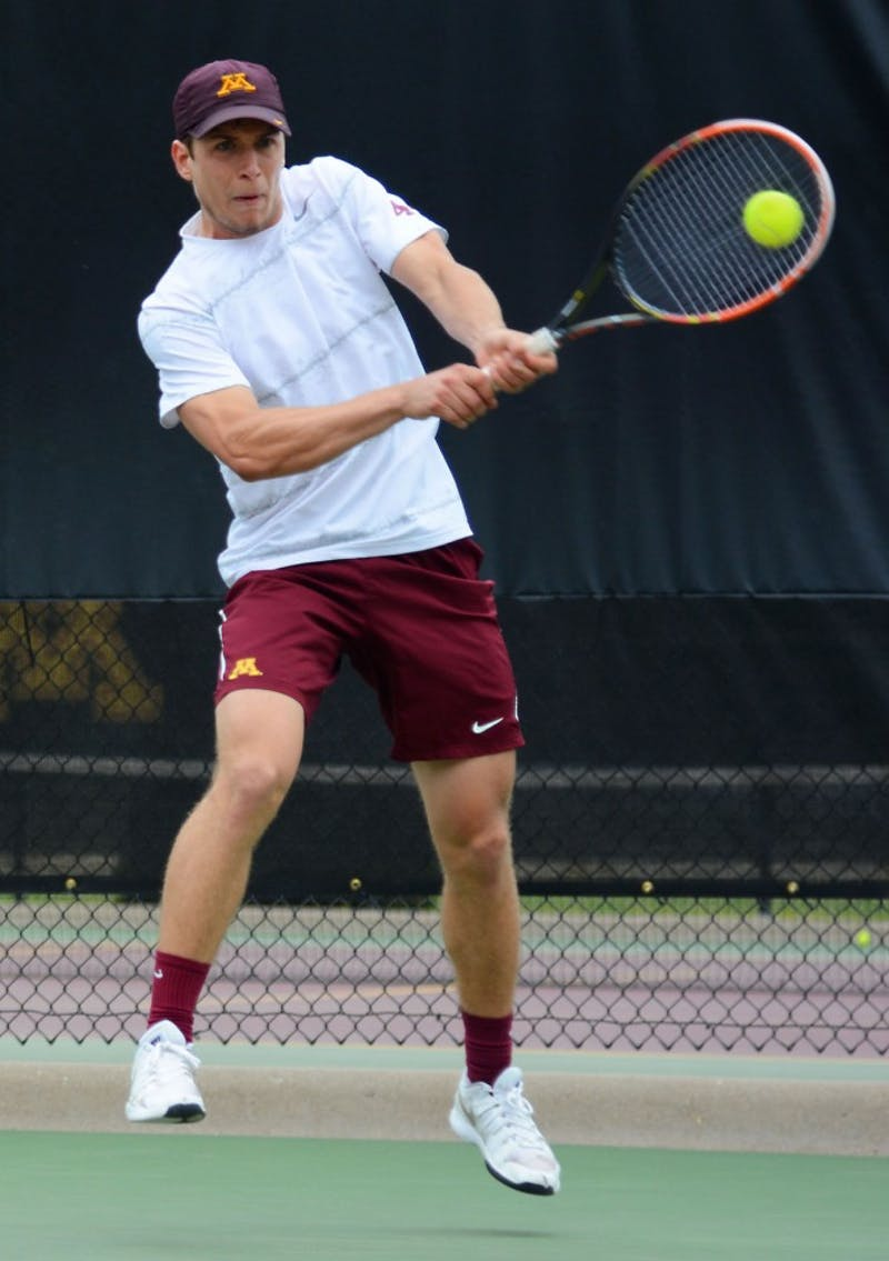Freshman Matic Spec returns a shot at the Baseline Tennis Center on April 19.