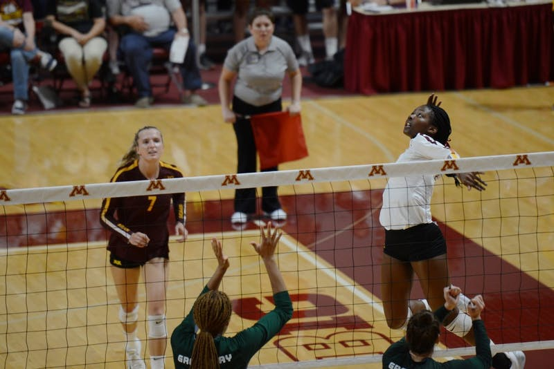 Freshman Adanna Rollins spikes a ball during the game on Thursday, Sept. 13 at Maturi Pavilion. Gopher women's volleyball defeated Green Bay in three straight sets.