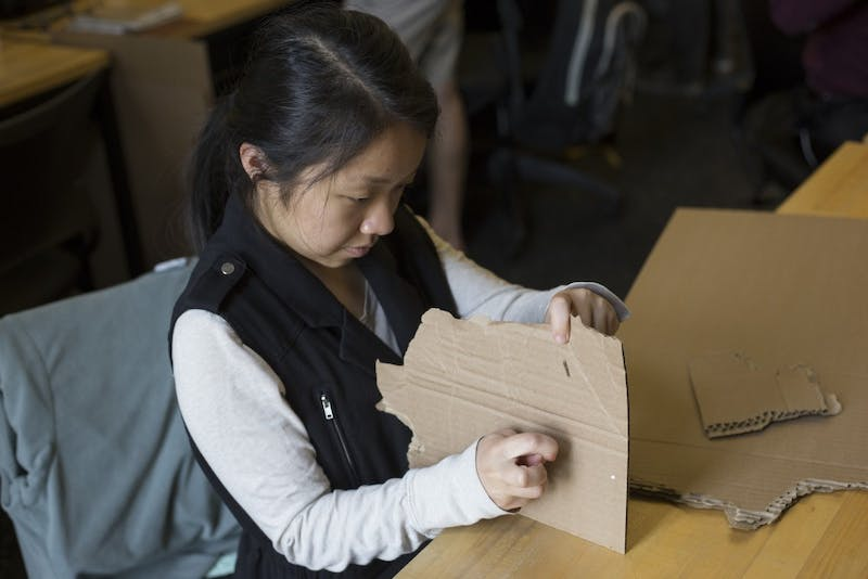 Architecture senior Belinda Xiong creates a cardboard model to represent a juvenile corrections facility at Rapson Hall on Monday, Sept. 24 on East Bank campus. Xiong and her class visited an adult correctional facility and a rehabilitation facility to learn firsthand how the spaces work.