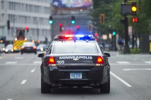 Minneapolis Police drive downtown on Tuesday, June 26.