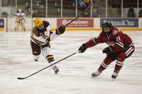 Defender Olivia Knowles looks to shoot the puck on Saturday, Oct. 13, at Ridder Arena. The Gophers beat St. Cloud State 4-1.