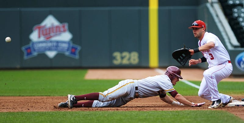 Minnesota catcher Mark Tatera dives back toward first base Friday, May 24, 2013, during the Big Ten tournament at Target Field. The Gophers lost 7-4 to Nebraska and finished fourth in the six-team tournament.
