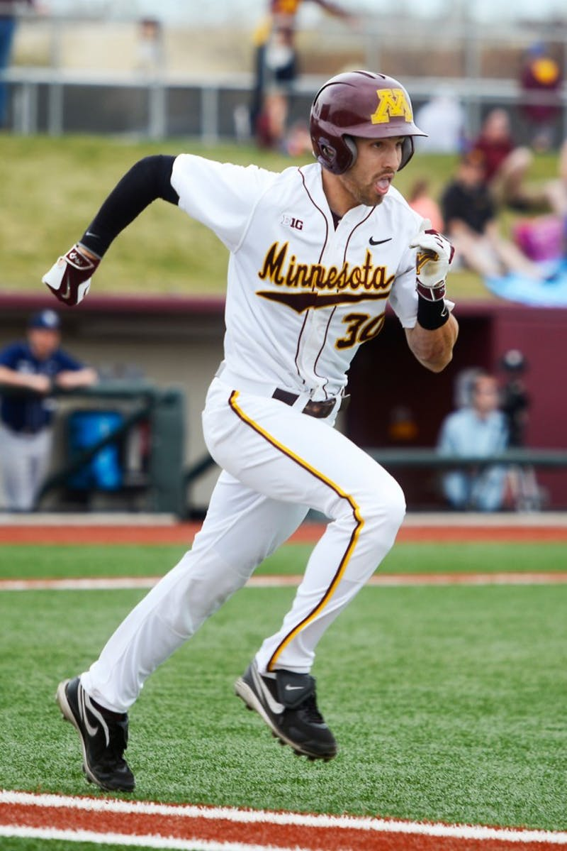 Senior outfielder Dan Motl sprints to first base at Siebert Field, where the Gophers baseball team took on Penn State on April 18, 2015.