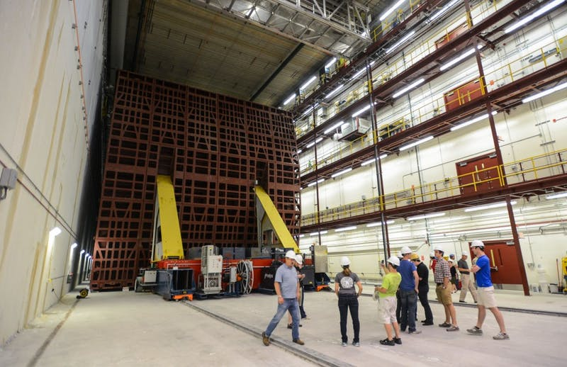 Members of a tour group take photos while observing the world-class NOvA far detector Thursday afternoon in Ash River, Minn.  The 14,000-ton detector is one of the world's largest free-standing plastic structures.