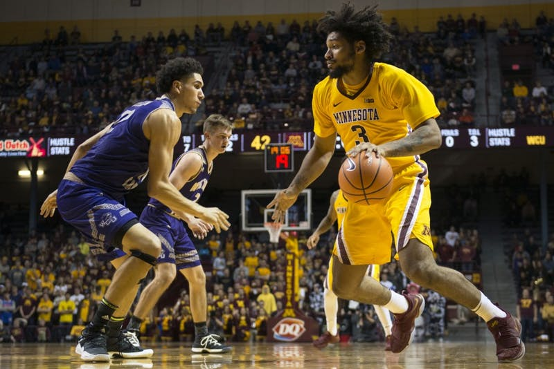 Forward Jordan Murphy looks to drive towards the hoop at the Williams Arena on Sunday, Nov. 19, 2017.