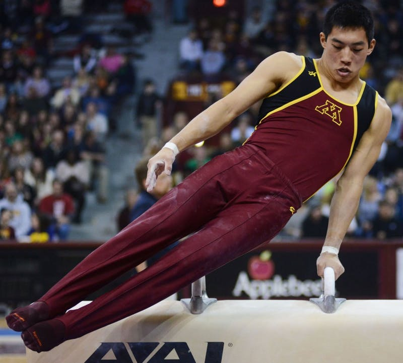Minnesota's Justin Morinishi competes on the pommel horse Saturday, Feb. 2, 2013, at the Sports Pavilion.