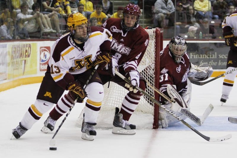 Junior Nico Sacchetti carries the puck into a wrap around behind the University of Massachusetts Amherst's goal Friday at Mariucci Arena.