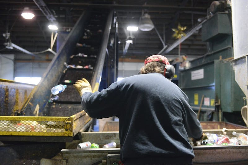 Utility worker Jeff Berry sorts plastic, aluminum and tin at the Como Recycling Facility in Minneapolis on Friday, Feb. 3, 2017.