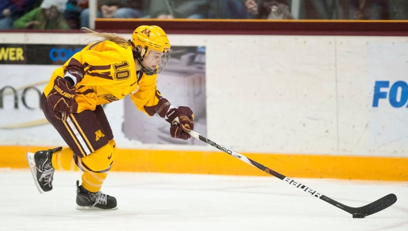 Gophers sophomore Kelly Terry handles a puck during a game against North Dakota Feb. 18 at Ridder Arena.