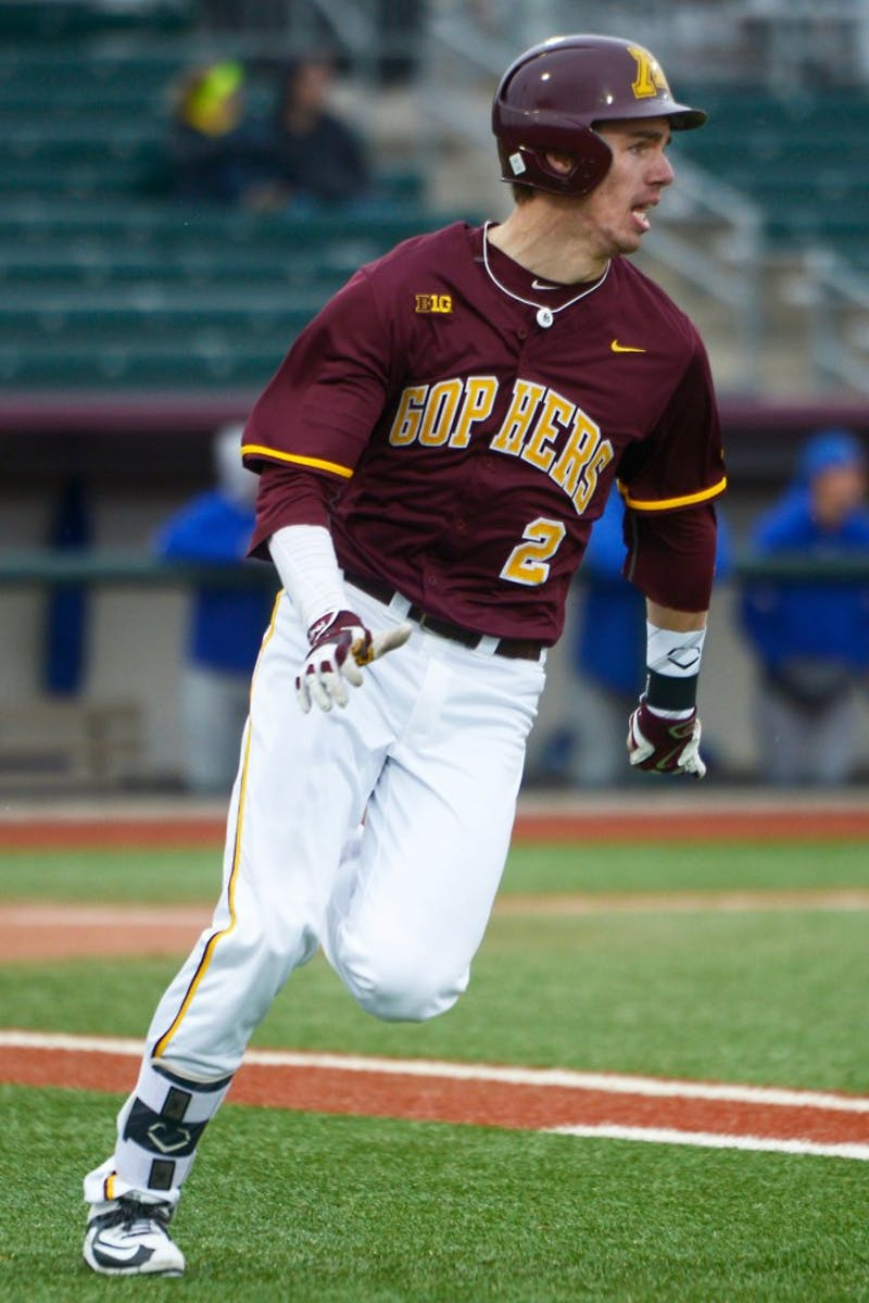 Sophomore Alex Boxwell runs to first base during the Gophers' game against South Dakota State at Siebert Field on April 13.