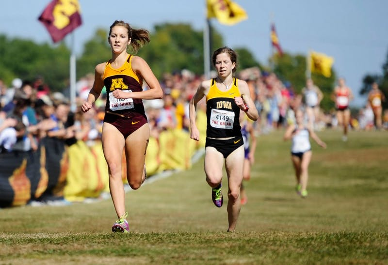 Minnesota junior Laura Docherty runs at the Jack Johnson Women's Gold - Division I on Saturday, Sept. 29, 2012, at Les Bolstad Golf Course in St. Paul, Minn.