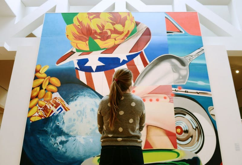 """Freshman Emily Simmons gazes at James Rosenquist's """"World's Fair Mural"""" on Thursday, Jan. 24, 2013, at the Weisman Art Museum. Simmons says she tries to come into the museum once a month because she finds art very relaxing, and it takes her mind off other things."""